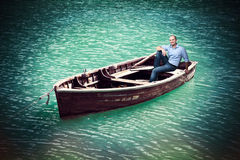 Man on old boat Royalty Free Stock Photos