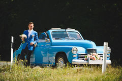 Man By Old Cabriolet. Man by old blue cabriolet in grass Royalty Free Stock Image