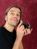 Man with old camera Royalty Free Stock Photos