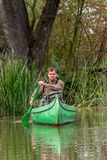 Man in old canoe on the river - portrait Royalty Free Stock Photo