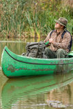 Man in old canoe on the river - portrait Stock Photo