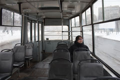 Man in a old cold tram Stock Image