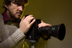 Man with old film movie camera. Stock Photography