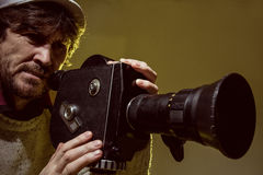 Man with old film movie camera. Shooting of the film Stock Images