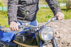 Man with old motorcycle Stock Image