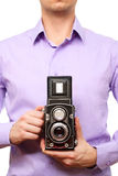 Man with old photo camera. Close up image of man with old photo camera. Isolated over white background royalty free stock image