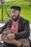 A man with an old Russian musical instrument in hand, Royalty Free Stock Photos