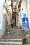 Man in idyllic alley with stairs,Yangshuo, China Stock Photos