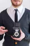 Man with old style camera. Royalty Free Stock Image