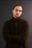 Man in an old sweater. Young man in an old sweater on a dark background. studio portrait Stock Photo