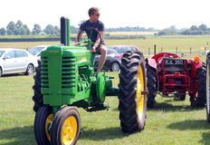 Man on an old tractor. Stock Photo