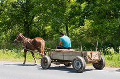 Man and old wooden cart Stock Photo