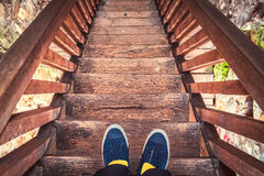 Man on old wooden stairs Royalty Free Stock Photos