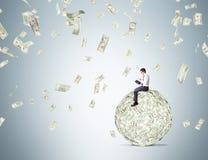 Free Man On Dollar Ball Reading Stock Photo - 68122890