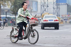 Man On Electric Bike In Beijing City Center, China Royalty Free Stock Images
