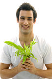 Man On Holding A Small Plant Stock Photography