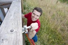 Man On Ladder - Horizontal Stock Image