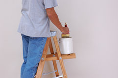 Man On Ladder Painting Stock Photo