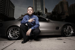 Man On The Street With His Luxury Sports Car Royalty Free Stock Photography