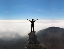 Free Man On The Top Of A Rock Royalty Free Stock Images - 5472329