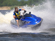Man On Wave Runner Turns Fast Royalty Free Stock Photo