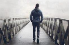 Free Man On Wooden Bridge A Misty Autumn Day. Stock Photo - 198233780