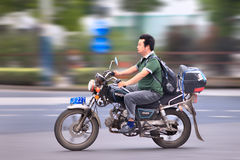 Man ona Chinese Wonjan motorcycle, Shanghai, China Royalty Free Stock Photos