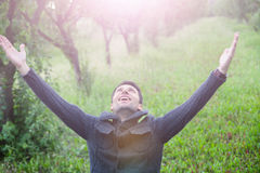 Man with open arms looking up. Young man with open arms looking up royalty free stock photo