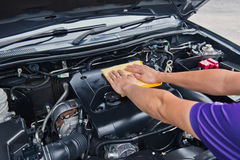 Man open the car hood and polishing car with microfiber cloth Royalty Free Stock Image