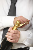 Man open champagne bottle Royalty Free Stock Photo