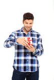 Man open a gift box. Handsome man portrait with a gift in his hands Royalty Free Stock Photography