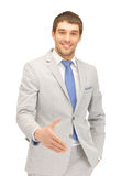 Man with an open hand ready for handshake Royalty Free Stock Image