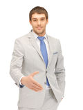 Man with an open hand ready for handshake Royalty Free Stock Photos