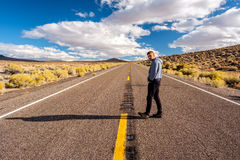 Man at open highway Stock Photo