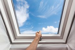 Free Man Open New Skylight Mansard Window In An Attic Room Against Blue Sky. Royalty Free Stock Images - 106308609
