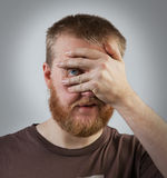 Man opened one eye and looks at us Royalty Free Stock Photo