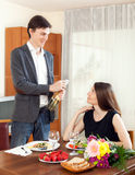 Man opened sparkling wine and having romantic dinner Stock Image