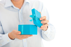 Man opening a birthday or Christmas gift Royalty Free Stock Photo
