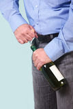 Man opening a bottle of white wine Royalty Free Stock Image