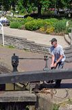 Man opening canal lock, Stratford-upon-Avon. Stock Photography