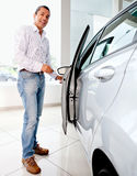 Man opening a car Stock Images