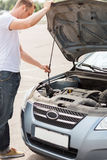 Man opening car bonnet Royalty Free Stock Photo