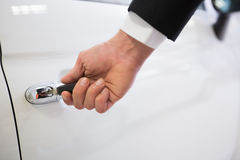 Man opening a car with a key Stock Image