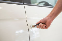 Man opening a car with a key Royalty Free Stock Photos
