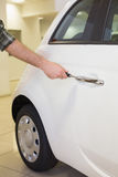 Man opening a car with a key Royalty Free Stock Image