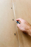 Man opening a cardboard with furniture Royalty Free Stock Images