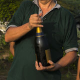 Man opening champagne Stock Photography