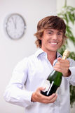 Man opening champagne Stock Image