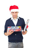 Man opening Christmas gift Stock Photography