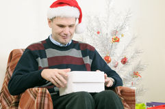 Man opening Christmas gift Stock Image